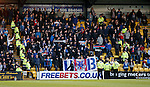 Police and stewards pen in a section of Rangers fans after pyrotechnics were used