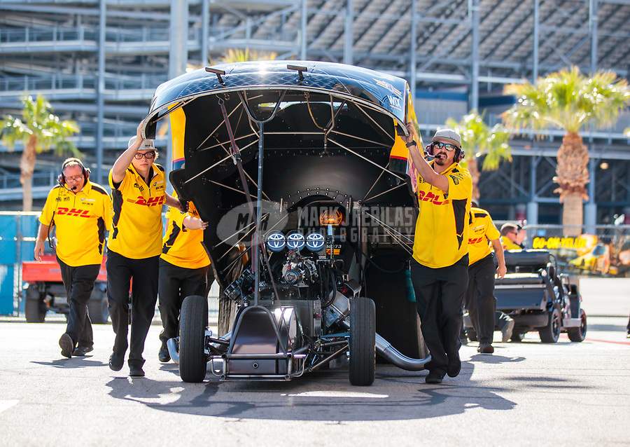 Oct 26, 2018; Las Vegas, NV, USA; Crew members push the car of NHRA funny car driver J.R. Todd during qualifying for the Toyota Nationals at The Strip at Las Vegas Motor Speedway. Mandatory Credit: Mark J. Rebilas-USA TODAY Sports