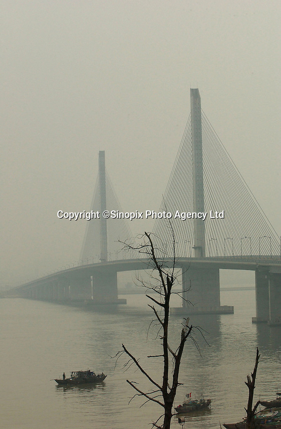 Qiaodao Bridge in Zhuhai, Guangdong Province, China. The bridge one of several white elephants constructed by the Zhu Kuan Group owned by the Zhuhai Municipal Government. The group has over 750 million US$ in outstanding debt largely owed to forign investors..17-NOV-03