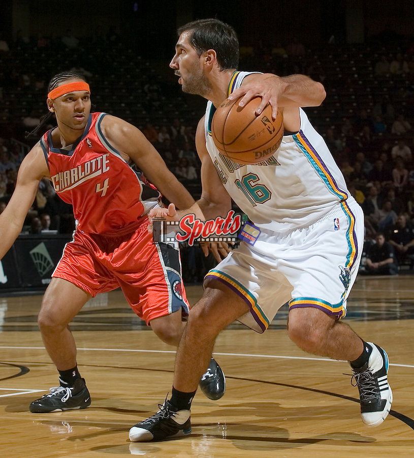 New Orleans Hornets' Peja Stojakovic (16) is watched closely by Charlotte Bobcats' Jared Dudley (4) at the LJVM Coliseum in Winston-Salem, NC, Friday, October 26, 2007.