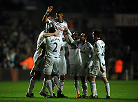 Pictured: Scott Sinclair of Swansea is lifted up by team mates celebrating after scoring his opening goal. Tuesday, 31 January 2012<br /> Re: Premier League football Swansea City FC v Chelsea FCl at the Liberty Stadium, south Wales.