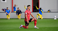 Lincoln City's Lewis Montsma takes a knee in support of the Black Lives Matter movement<br /> <br /> Photographer Chris Vaughan/CameraSport<br /> <br /> The EFL Sky Bet League One - Saturday 12th September 2020 - Lincoln City v Oxford United - LNER Stadium - Lincoln<br /> <br /> World Copyright © 2020 CameraSport. All rights reserved. 43 Linden Ave. Countesthorpe. Leicester. England. LE8 5PG - Tel: +44 (0) 116 277 4147 - admin@camerasport.com - www.camerasport.com - Lincoln City v Oxford United