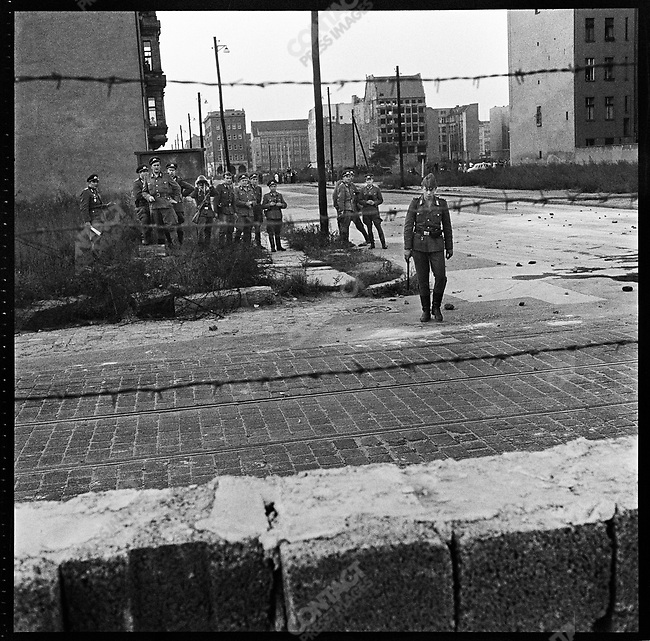 View of East German soldiers on the other side of the Berlin wall at the time of the it's construction, West Berlin, Germany, August 1961