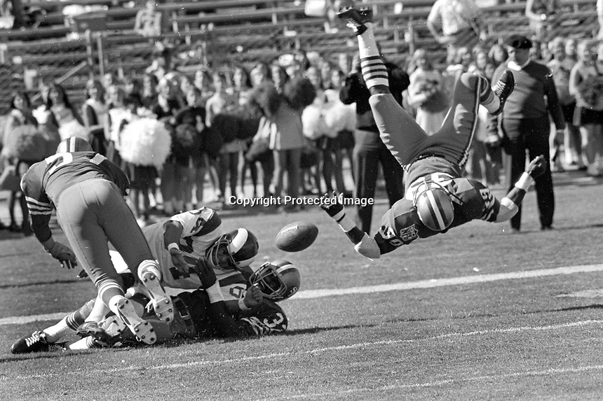 San Francisco 49er KermitAlexander is upended after breaking up a Los Angeles Rams pass, Frank Nunley and Jimmy Johnson help. (1969 photo/Ron Riesterer)