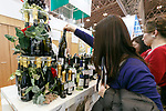 A visitor looks at an Italian wine during the 42nd International Food and Beverage Exhibition (FOODEX JAPAN 2017) in Makuhari Messe International Convention Complex on March 8, 2017, Chiba, Japan. About 3,282 companies from 77 nations are participating in the Asia's largest food and beverage trade show. This year organizers expect 77,000 visitors for the four-day event, which runs until March 10. (Photo by Rodrigo Reyes Marin/AFLO)