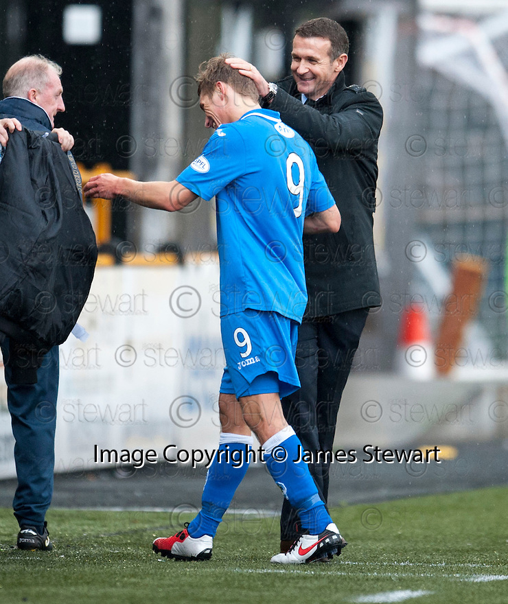 Queen of the South third goal scorer Gavin Reilly gets a pat on the head by manager Jim McIntyre as he is substituted.