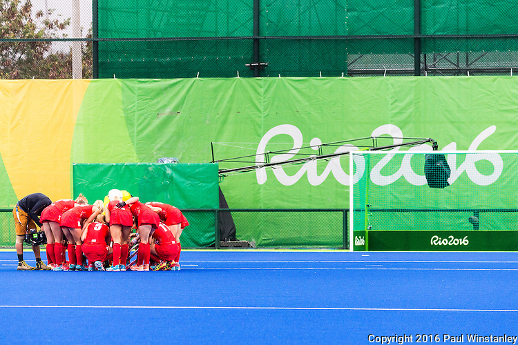 Great Britain team huddle before the start of Argentina vs Great Britain in women's Pool B game  at the Rio 2016 Olympics at the Olympic Hockey Centre in Rio de Janeiro, Brazil.