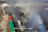 63818-02402 Firefighters extinguishing warehouse fire using aerial ladder truck viewed from top of ladder, Salem, IL