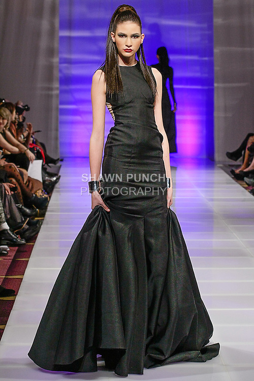 Model walks runway in an outfit from the Sinead Fachelli Fall Winter 2013 collection, by Sinead Fachelli Castellanos, during Couture Fashion Week New York Fall 2013, on 02/15/13.