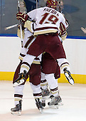 Jimmy Hayes (BC - 10), Ben Smith (BC - 12) and Chris Kreider (BC - 19) celebrate Hayes' second goal which came 23 seconds after his first. - The Boston College Eagles defeated the Yale University Bulldogs 9-7 in the Northeast Regional final on Sunday, March 28, 2010, at the DCU Center in Worcester, Massachusetts.