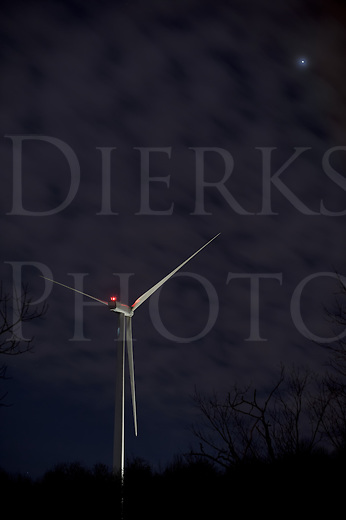 Wind energy windmill turbine at night under fluffy clouds and stars, short trails visible, eight second time exposure, clean shot using Nikon D3s at ISO 200, Altoona, PA, USA.
