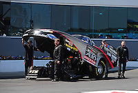 Apr. 13, 2012; Concord, NC, USA: NHRA crew members for funny car driver Blake Alexander during qualifying for the Four Wide Nationals at zMax Dragway. Mandatory Credit: Mark J. Rebilas-