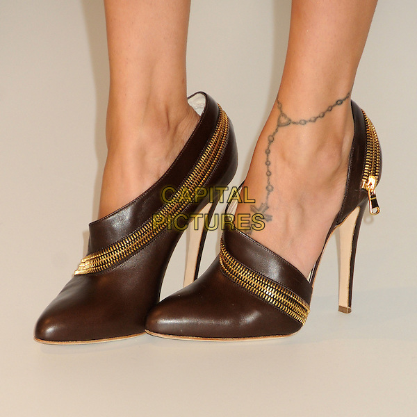 Nicole Richie's shoes .launches her 'Nicole' fragrance at Macy's Glendale Galleria, Glendale, California, USA..29th August 2012.zip zippers tattoo brown black shoes gold  perfume.CAP/ADM/BP.©Byron Purvis/AdMedia/Capital Pictures.