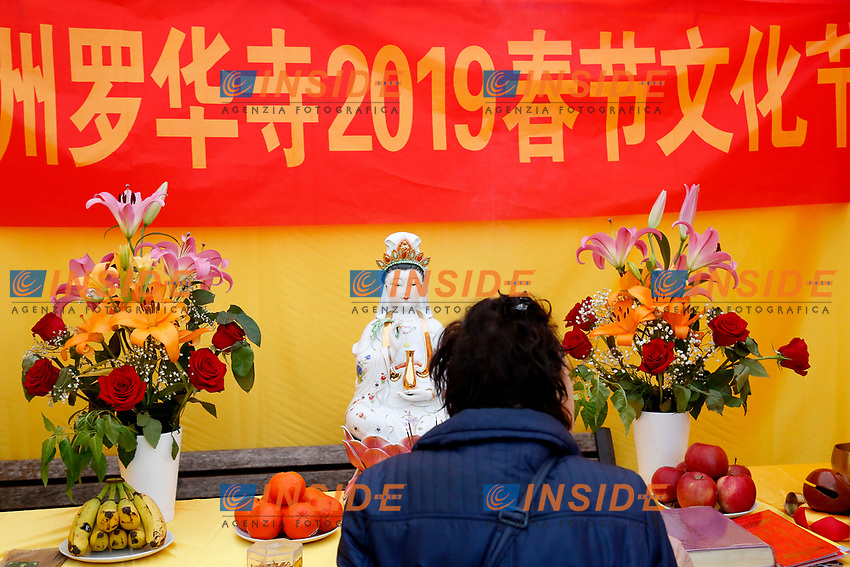 A woman praying in a temple<br /> Rome February 10th 2019. Celebrations for Chinese New Year 2019 in Rome. This year begins the year of the pig.<br /> Foto Samantha Zucchi Insidefoto