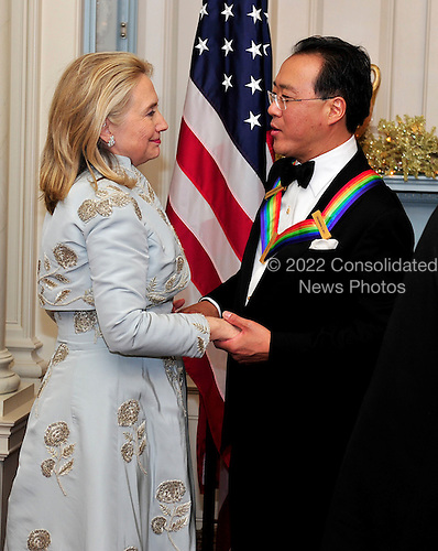 Yo-Yo Ma, one of the five recipients of the 2011 Kennedy Center Honors, shares some thoughts with United States Secretary of State Hillary Rodham Clinton following a dinner hosted by Secretary Clinton at the U.S. Department of State in Washington, D.C. on Saturday, December 3, 2011. The 2011 honorees are actress Meryl Streep, singer Neil Diamond, actress Barbara Cook, musician Yo-Yo Ma, and musician Sonny Rollins..Credit: Ron Sachs / CNP