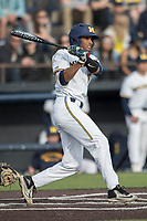 Michigan Wolverines outfielder Johnny Slater (25) follows through on his swing against the Michigan State Spartans during the NCAA baseball game on April 18, 2017 at Ray Fisher Stadium in Ann Arbor, Michigan. Michigan defeated Michigan State 12-4. (Andrew Woolley/Four Seam Images)