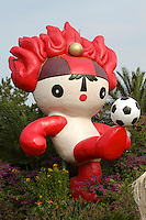 """Tian'anmen Square (Place of Heavenly Peace). Flower display with Beijing 2008 Olympics mascots (""""Friendlies""""): fiery Huanhuan."""