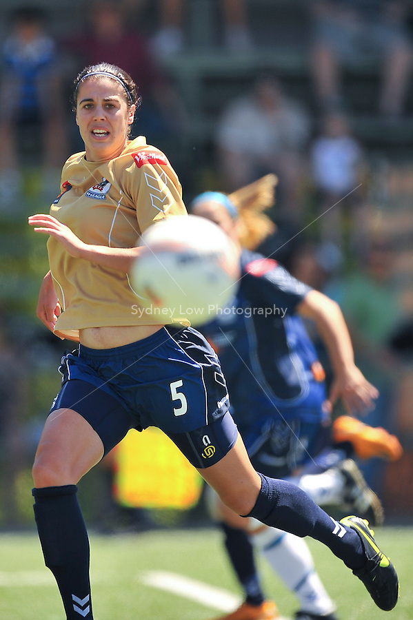 MELBOURNE, AUSTRALIA - OCTOBER 31: Stacey DAY from Newcastle kicks the ball in round 5 of the Westfield W-league match between Melbourne Victory and Newcastle Jets at the Veneto Club on October 31, 2009 in Melbourne, Australia. Photo Sydney Low www.syd-low.com