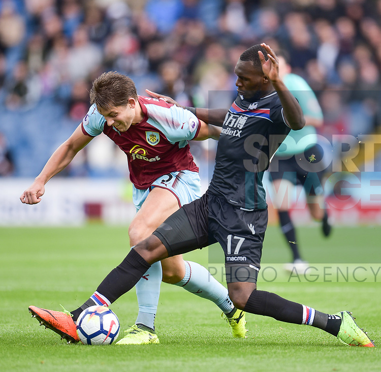 Crystal Palace's Christian Benteke and Burnley's James Tarkowski in action during the premier league match at the Turf Moor Stadium, Burnley. Picture date 10th September 2017. Picture credit should read: Paul Burrows/Sportimage