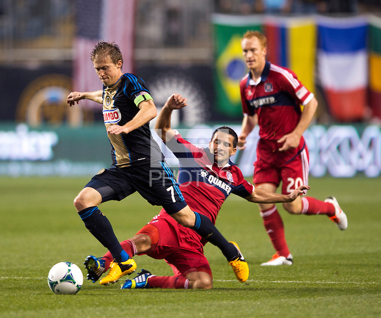 Dilly Duka (8) of the Chicago Fire tries to tackle the ball away from Brian Carroll (7) of the Philadelphia Union during a Major League Soccer match at PPL Park in Chester, PA.  Philadelphia defeated Chicago, 1-0.