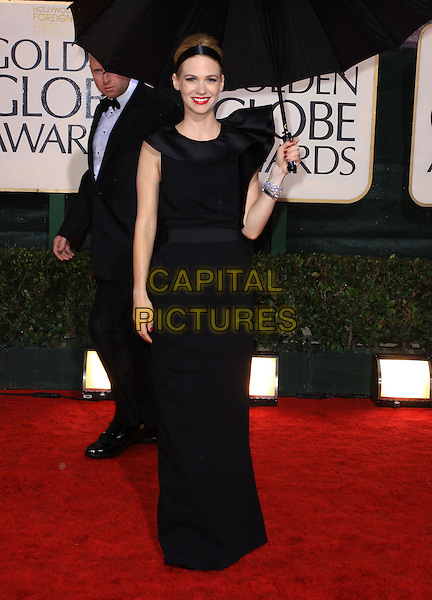 JANUARY JONES.67th Golden Globe Awards held Beverly Hilton, Beverly Hills, California, USA..January 17th, 2010.globes full length black dress umbrella  .CAP/ADM/KB.©Kevan Brooks/Admedia/Capital Pictures