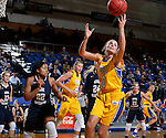 BROOKINGS, SD - DECEMBER 11:  Kerri Young #10 from South Dakota State University comes down with the rebound against George Washington during their game Sunday afternoon at Frost Arena in Brookings. (Photo by Dave Eggen/Inertia)