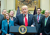 """United States President Donald J. Trump makes remarks prior to signing H.J. Res. 38, disapproving the rule submitted by the US Department of the Interior known as the Stream Protection Rule in the Roosevelt Room of the White House in Washington, DC on Thursday, February 16, 2017.  The Department of Interior's Stream Protection Rule, which was signed during the final month of the Obama administration, """"addresses the impacts of surface coal mining operations on surface water, groundwater, and the productivity of mining operation sites,"""" according to the Congress.gov summary of the resolution.<br /> Credit: Ron Sachs / Pool via CNP"""