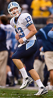 North Carolina quarterback T.J. Yates (13) celebrates a touchdown against West Virginia during the Meineke Car Care Bowl college football game at Bank of America Stadium in Charlotte, NC.