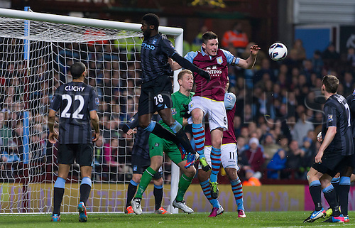 04.03.2013 Birmingham, England. Aston Villa's Ciaran Clark (Capt) and Manchester City's Kolo Toure and Joe Hart in action during the Premier League game between Aston Villa and Manchester City from Villa Park.