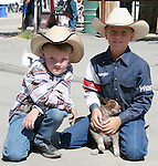Jace Nelson, left, and Blain Jensen with his new puppy.  Photo by Tom Smedes.