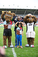 Mo Farah with the Harlequins' mascots during the Aviva Premiership match between Harlequins and Saracens at the Twickenham Stoop on Sunday 30th September 2012 (Photo by Rob Munro)