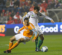 Chicago midfielder Baggio Husidic (9) tries to get past Houston midfielder Geoff Cameron (20).  The Chicago Fire defeated the Houston Dynamo 2-0 at Toyota Park in Bridgeview, IL on April 24, 2010.