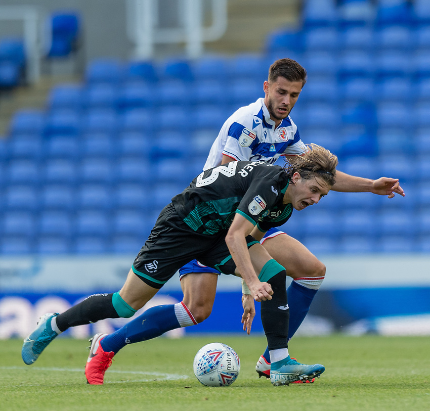 Reading's Matt Miazga (left) battles for possession with Swansea City's Conor Gallagher (right) <br /> <br /> Photographer David Horton/CameraSport<br /> <br /> The EFL Sky Bet Championship - Reading v Swansea City - Wednesday July 22nd 2020 - Madejski Stadium - Reading <br /> <br /> World Copyright © 2020 CameraSport. All rights reserved. 43 Linden Ave. Countesthorpe. Leicester. England. LE8 5PG - Tel: +44 (0) 116 277 4147 - admin@camerasport.com - www.camerasport.com