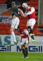 Dundee Utd's Gavin Gunning clears from Partick's Christie Elliot as Dundee Utd's John Rankin ducks for cover.