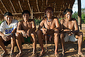 Xingu Indigenous Park, Mato Grosso State, Brazil. Aldeia Moygu (Ikpeng); four elders sitting in the Men's Hut.