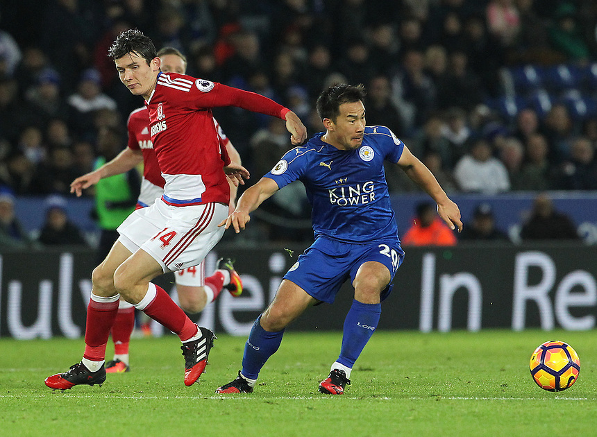Leicester City's Shinji Okazaki in action during todays match  with Middlesbrough's Marten de Roon<br /> <br /> Photographer Rachel Holborn/CameraSport<br /> <br /> The Premier League - Leicester City v Middlesbrough - Saturday 26th November 2016 - King Power Stadium - Leicester<br /> <br /> World Copyright &copy; 2016 CameraSport. All rights reserved. 43 Linden Ave. Countesthorpe. Leicester. England. LE8 5PG - Tel: +44 (0) 116 277 4147 - admin@camerasport.com - www.camerasport.com