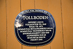 Tollboden building plaque with dates, Tromso, Norway