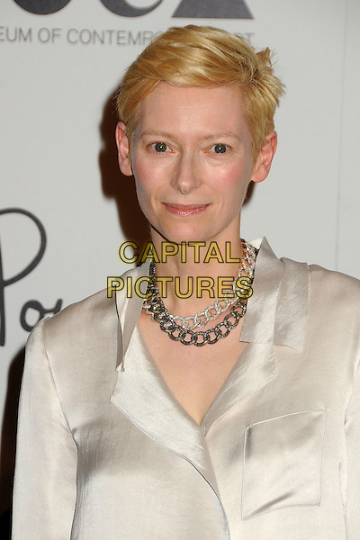 Tilda Swinton.Pomellato Celebrates Rodeo Drive Boutique Opening Hosted By Tilda Swinton, Benefiting MOCA held at Pomellato Boutique, Beverly Hills, California, USA..January 30th, 2012.headshot portrait white silk satin blouse gold silver necklaces .CAP/ADM/BP.©Byron Purvis/AdMedia/Capital Pictures.