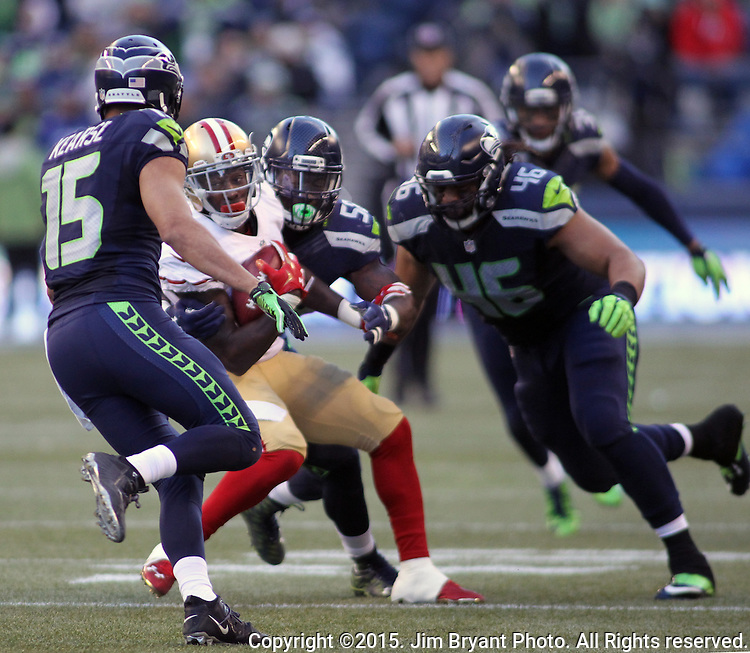 San Francisco 49ers kickoff return specialists Bruce Ellington (10)  is surrounded by Seattle Seahawks at CenturyLink Field in Seattle, Washington on November 22, 2015.  The Seahawks beat the 49ers 29-13.   ©2015. Jim Bryant Photo. All RIghts Reserved.