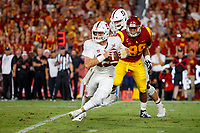 LOS ANGELES, CA - SEPTEMBER 8: Stanford Cardinal quarterback Davis Mills #15 scrambles with pressure from USC Trojans defensive lineman Christian Rector #89 during a game between USC and Stanford Football at Los Angeles Memorial Coliseum on September 7, 2019 in Los Angeles, California.