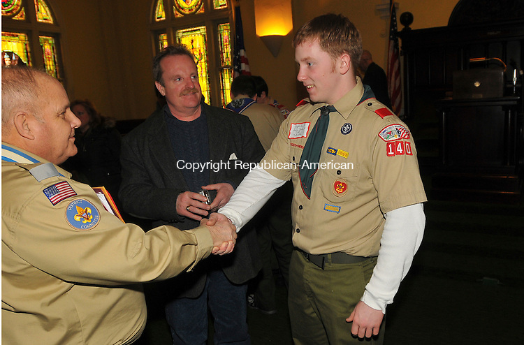 WATERBURY, CT-30 JANUARY 2010-013010IP04- Davis Finley of Troop 140 out of Oakville gets congratulated for receiving his Eagle Scout certificate by Hall Walling (far left), Eagle Advancement Coordinator of the Mad River District, as his father Harry Finley watches, during the Thirty-third Annual Eagle Scout Recognition Luncheon at the Waterbury Elks Lodge #265 on Saturday.  The Eagle Scout Class of 2009 included 42 people from the Mad River District. Eagle Scout is the highest rank attainable in the Boy Scouts of America.<br /> Irena Pastorello Republican-American