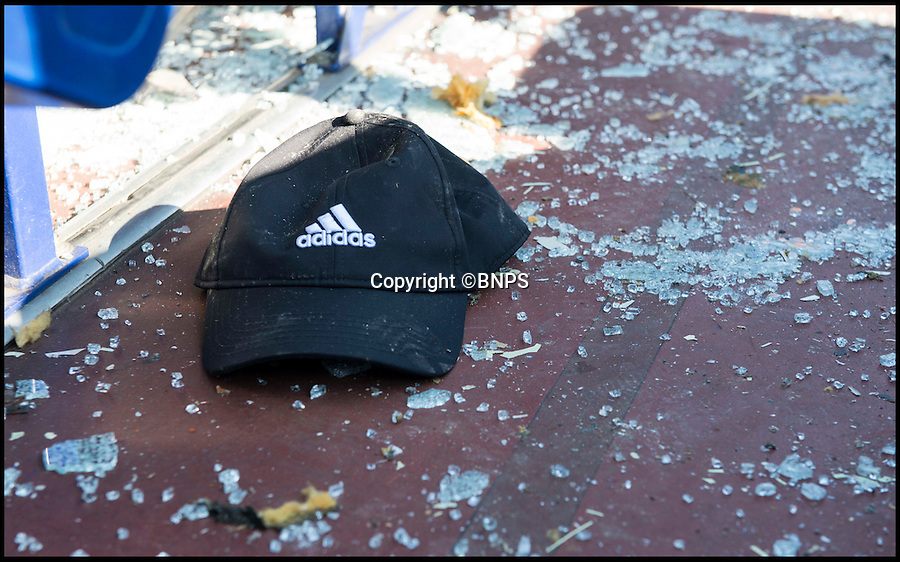 BNPS.co.uk (01202 558833)<br /> Pic: TomWren/BNPS<br /> <br /> A childs hat in amongst the chards of class.<br /> <br /> Students had a miraculous escape today after the roof of a double decker bus sheared off when it ploughed into a railway bridge next to a primary school.<br /> <br /> Teenagers on the top deck ducked at the moment the vehicle crashed, ripping off the headrests of their seats and slicing off the roof.<br /> <br /> The dramatic collision occurred just as hundreds of young children arrived at the primary school in Bournemouth with many lucky not to have been hit by the roof as it fell onto the road or by debris.