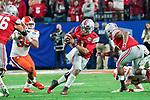 Ohio State Buckeyes quarterback Justin Fields (1) scrambles down field during the Fiesta Bowl game against the Clemson Tigers on Saturday, Dec 28, 2019 in Glendale, Ariz.  (Gene Lower via AP)