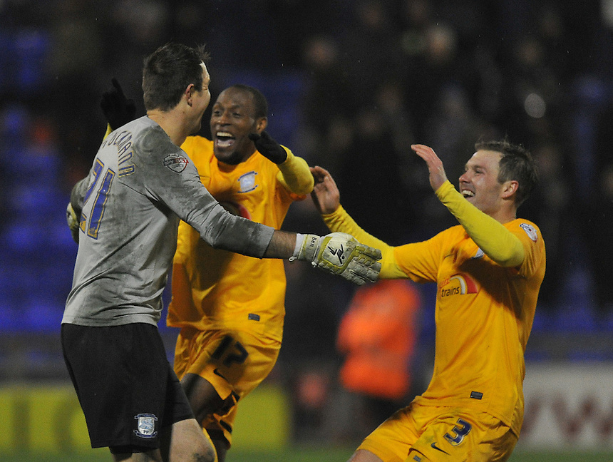 Preston North End's Thorsten Stuckmann is mobbed by team mates after scoring the winning penalty<br /> <br /> Photographer Dave Howarth/CameraSport<br /> <br /> Football - Johnstone's Paint Trophy Northern Area Quarter-Final - Oldham Athletic v Preston North End - Tuesday 25th November 2014 - SportsDirect.com Park - Oldham<br />  <br /> &copy; CameraSport - 43 Linden Ave. Countesthorpe. Leicester. England. LE8 5PG - Tel: +44 (0) 116 277 4147 - admin@camerasport.com - www.camerasport.com