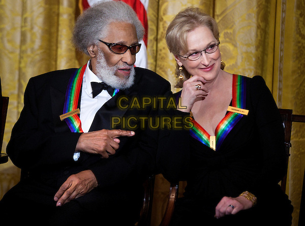 Sonny Rollins & Meryl Streep.arrives Kennedy Center Honors reception in the East Room of the White House, Washington, DC., USA..4th December 2011.half length black tuxedo glasses dress sitting beard facial hair hand pointing .CAP/ADM/CNP/BS.©BS/CNP/AdMedia/AdMedia/Capital Pictures