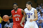 15 November 2014: Fairfield's Steve Johnston (23) and Duke's Grayson Allen (3). The Duke University Blue Devils hosted the Fairfield University Stags at Cameron Indoor Stadium in Durham, North Carolina in an NCAA Men's Basketball exhibition game. Duke won the game 109-59.