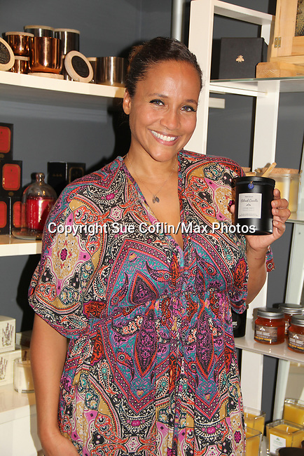 Guiding Light's Yvonna Kopacz Wright, owner of Lomar Farms in Palisades, New York where she as a beekeeper as makes beeswax candles and other products. Tonight May 4, 2018 Yvonna presented them at NiLu - gifts - lifestyle - home in Harlem where attendees viewed them, chatted, bought them. For more information go to www.lomarfarms.com. (Photo by Sue Coflin/Max Photo)