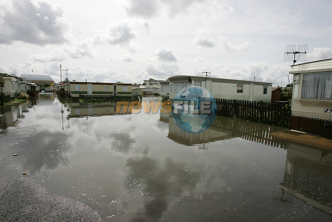 Caravans flooded from the severe weather that were are having, Familys left there mobile homes today after another night of Flooding in bettystown Co Meath...Photo: Fran Caffrey/ Newsfile.
