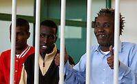 Da sinistra, Abdi Hassan Mahamur, Ahmed Malimed Ali ed Abdullahi Ali Ahmed, presunti pirati somali accusati dell'attacco alla nave portacontainer italiana Montecristo, durante la prima udienza del processo presso la III Corte d'Assise a Roma, 23 marzo 2012. La nave, assaltata il 10 ottobre 2011 al largo della Somalia, venne liberata il 15 ottobre dai Royal Marines britannici con l'ausilio di una nave militare statunitense..Somali allegedly pirates, from left, Mohamed Isse Karshe, Abdi Hassan Mahamur, Ahmed Malimed Ali and Abdullahi Ali Ahmed, sit inside a cage during the opening audience for the assault to the Montecristo container ship, in Rome, 23 march 2012. The ship was attacked on 10 october 2011 and freed by US navy and British Royal Marines on 15 october..UPDATE IMAGES PRESS/Riccardo De Luca