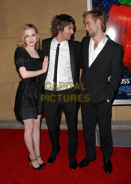 "EVAN RACHEL WOOD, JIM STURGESS & JOE ANDERSON .The L.A. Screening of ""Across the Universe"" held at The Egyptian Theatre in Hollywood, California, USA..September 18th, 2007                                                                                              .full length black suit dress double strap mary janes profile hand in pocket.CAP/DVS.©Debbie VanStory/Capital Pictures"